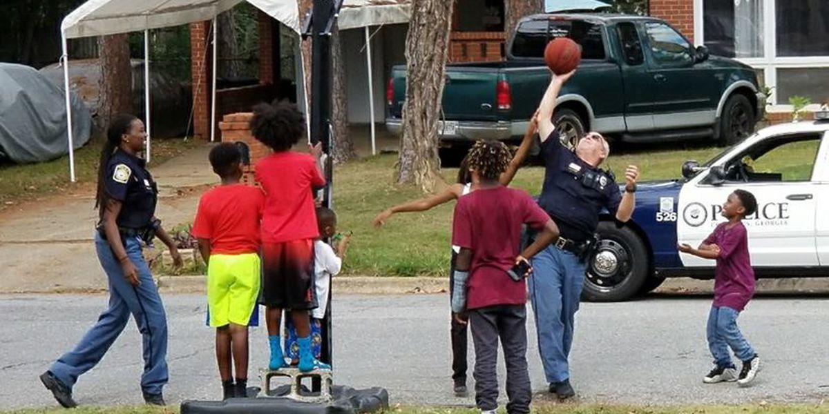 Columbus police officers join basketball game; leaves positive impact on boys