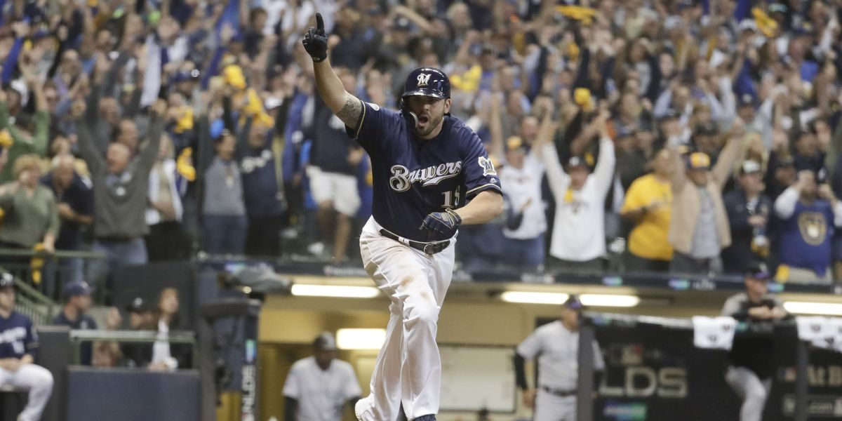 Moustakas scores Yelich in 10th, Brewers top Rox in opener