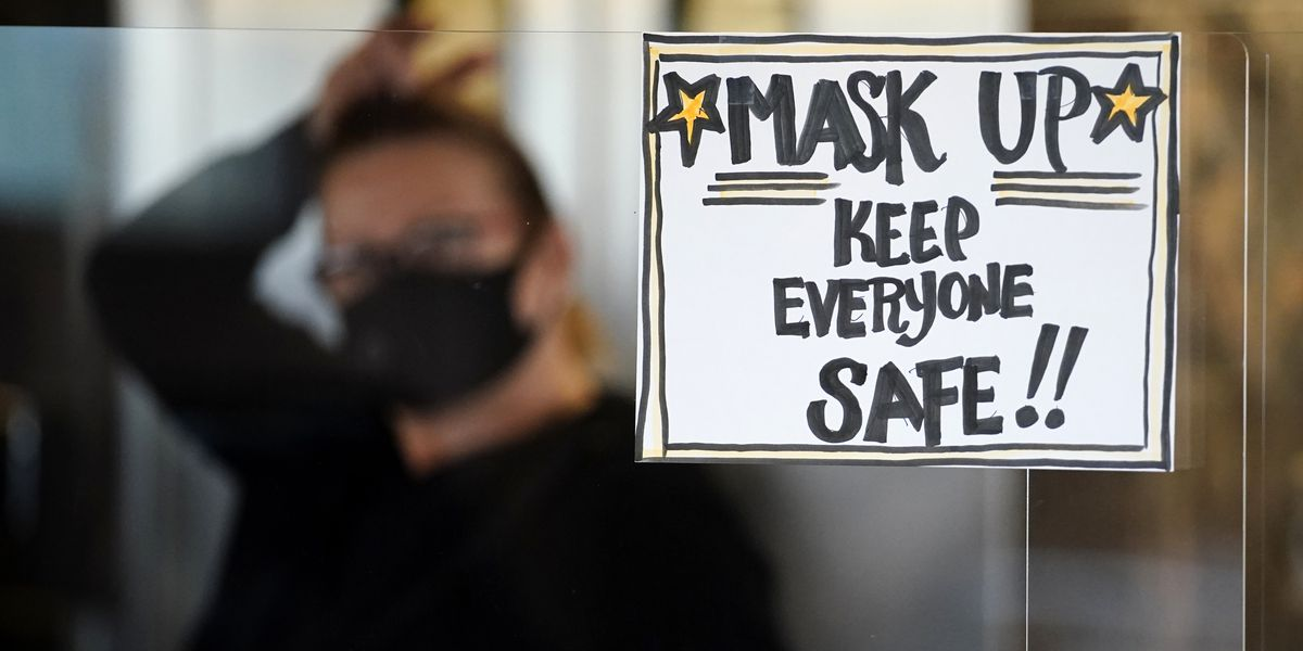 Keep the mask: A vaccine won't end the US crisis right away