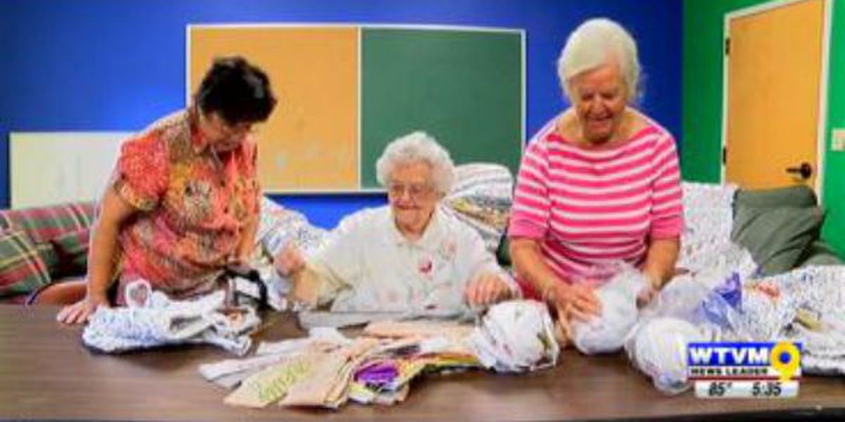 Ladies crochet plastic bags into mats for the homeless