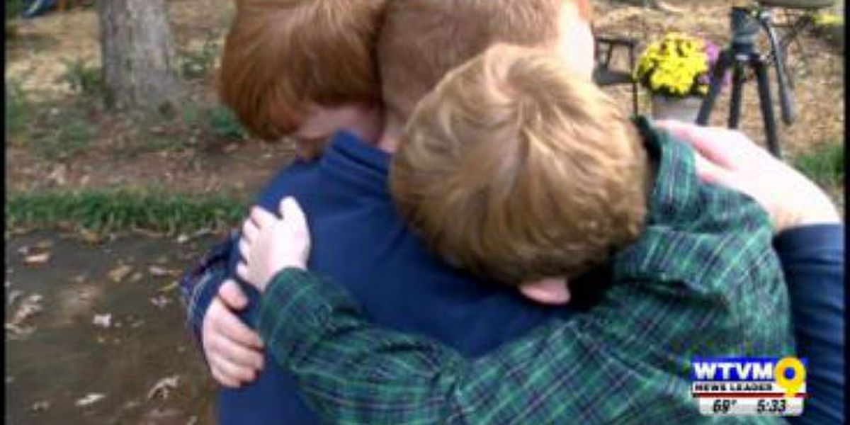 Surprise homecoming reunites Auburn veteran with sons