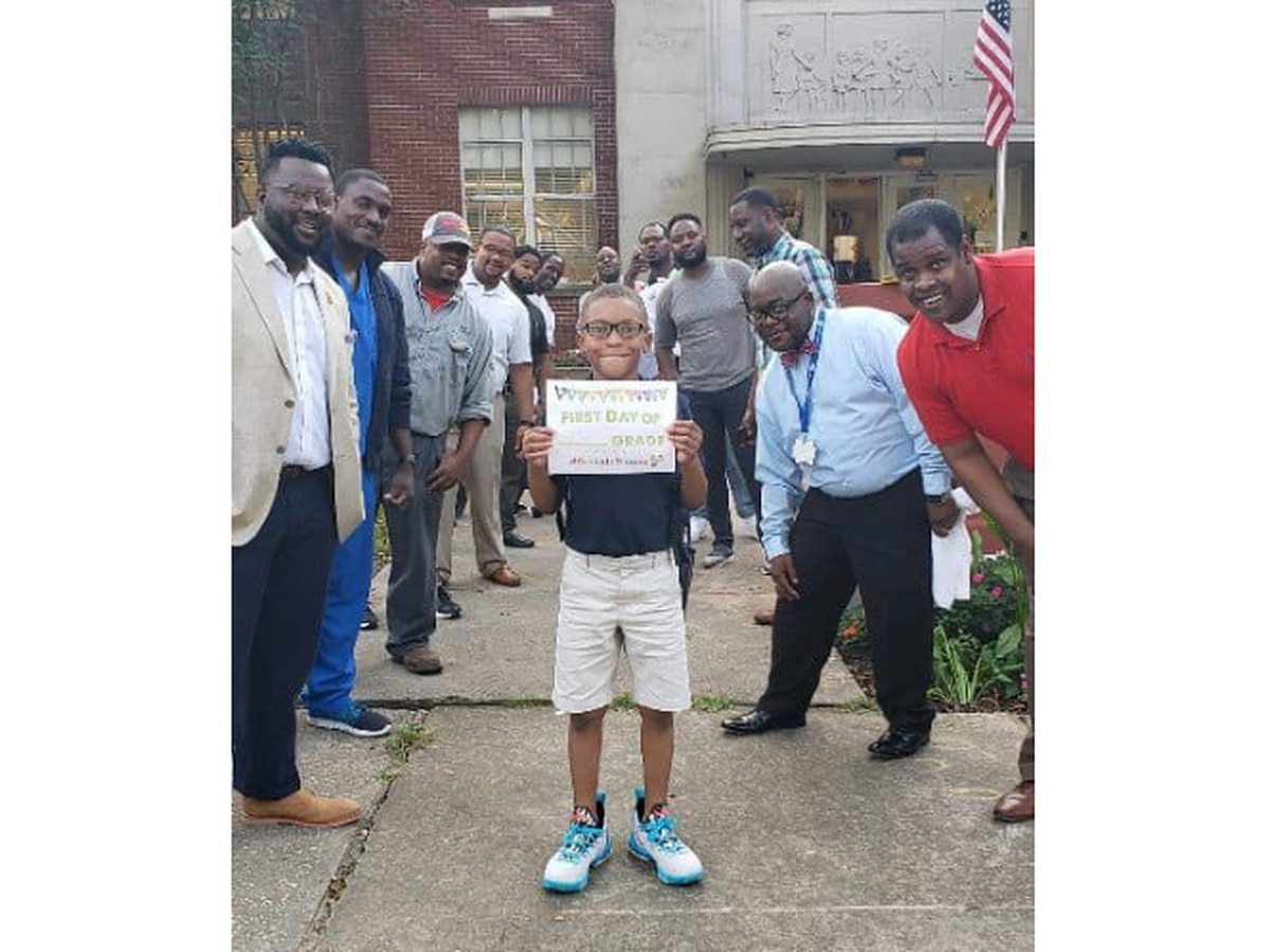 Dads line up to greet students on first day at Jackson elementary school