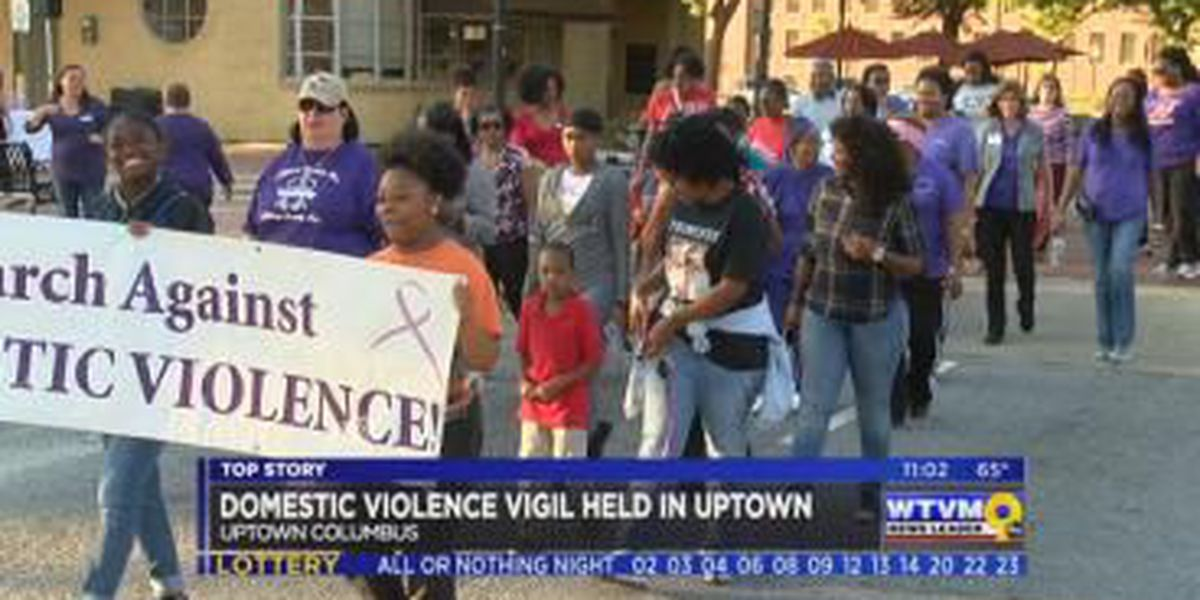 Columbus community honors victims of domestic violence with vigil march