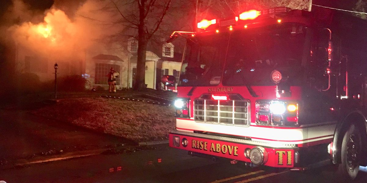 Firefighters battle house fire on Flintlock Drive in Columbus