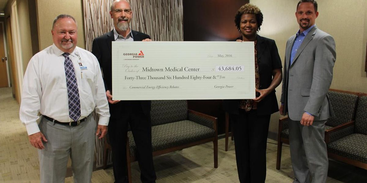 Georgia Power presents large rebate check to Midtown Medical Center