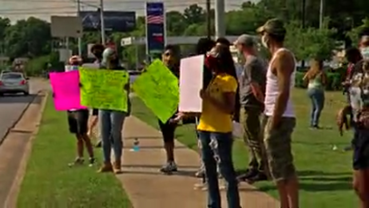 Protesters gather on Victory Dr. in Columbus for peaceful rally