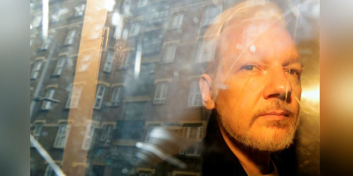 Assange extradition hearing paused over COVID-19 risk