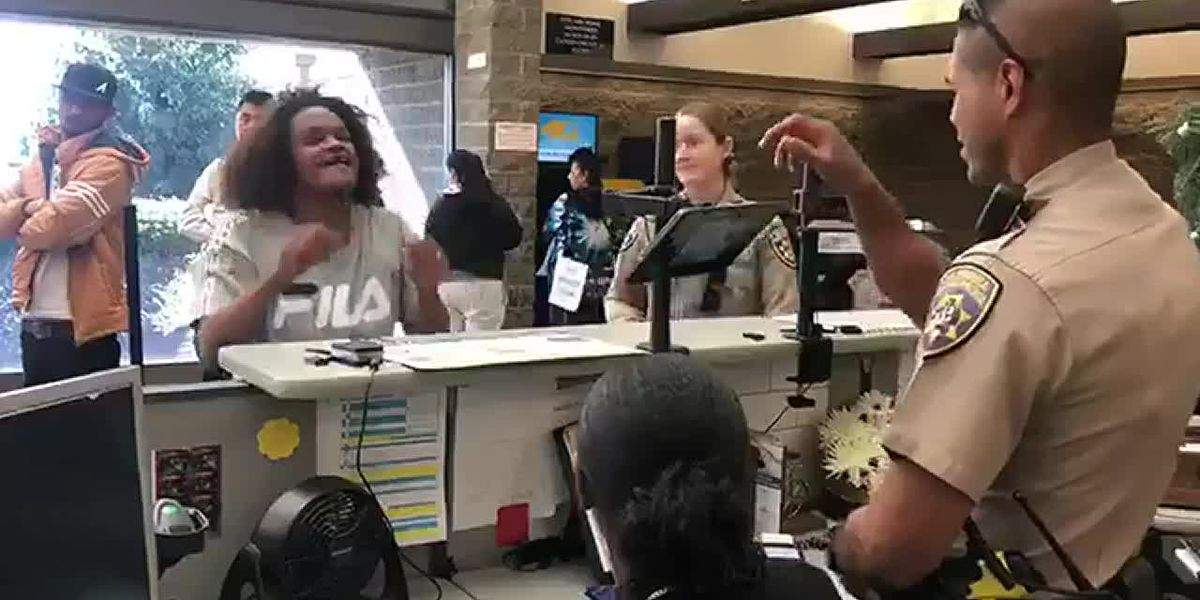 Officer uses sign language to help deaf woman at California DMV, pays for new ID