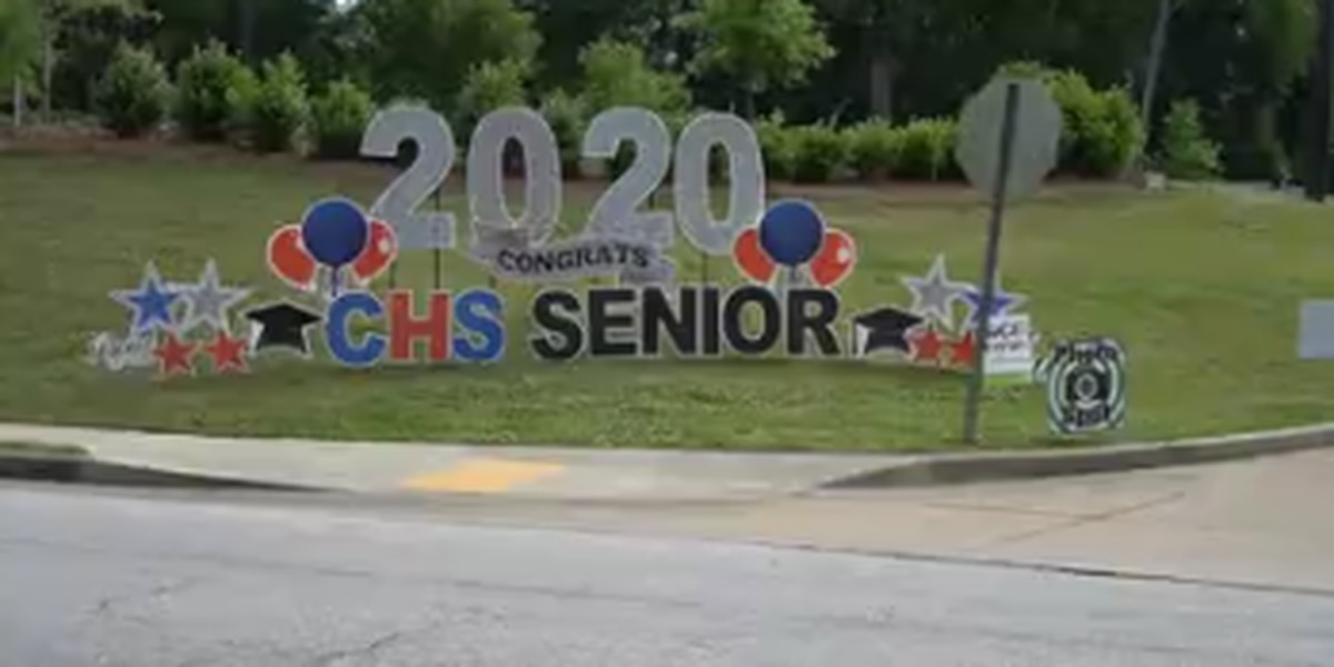 Columbus High students surprised with parade as they picked up cap and gowns