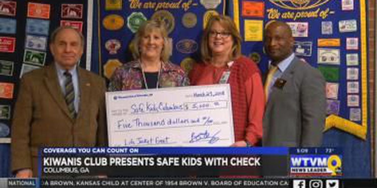 Kiwanis Club of Columbus presents SafeKids with $5K check