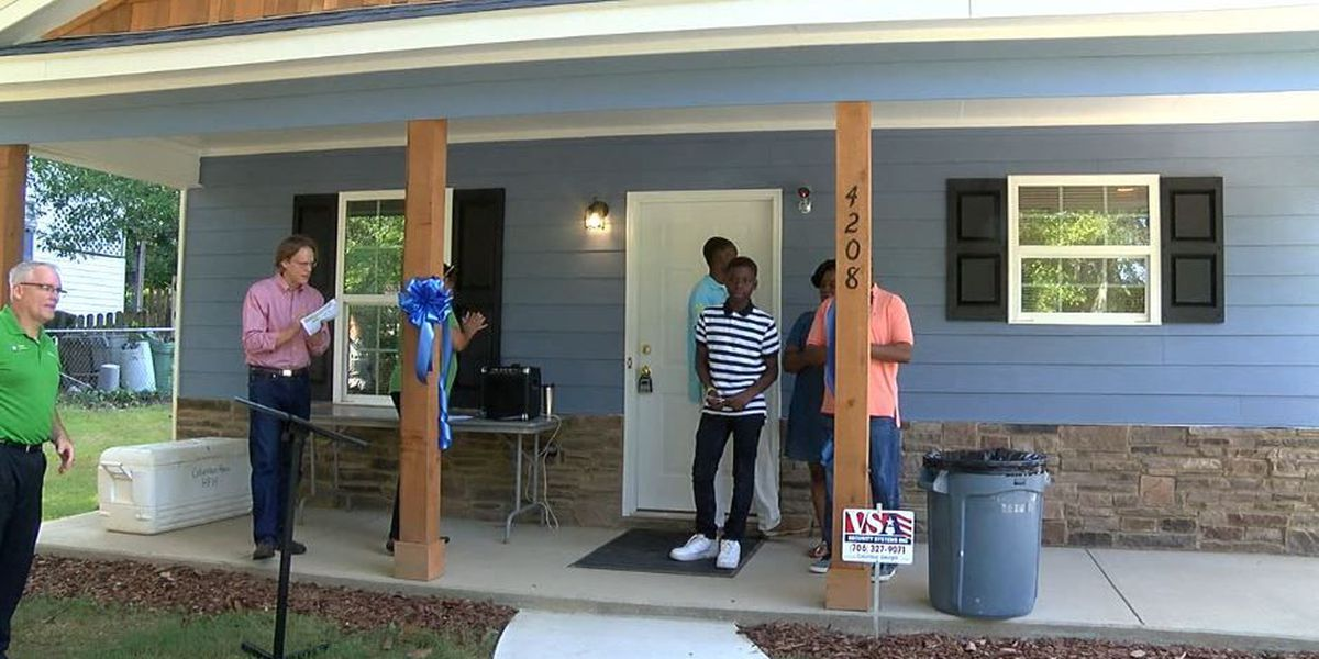 Family cuts ribbon on their Habitat for Humanity home