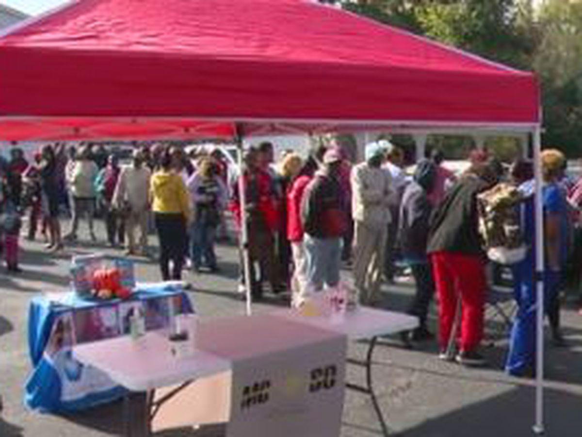 Forrest B. Johnson & Associates in Columbus host Thanksgiving turkey, ham voucher giveaway
