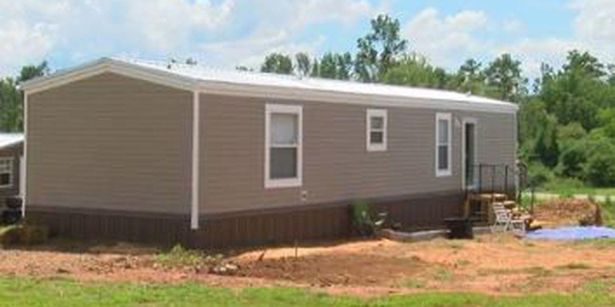Organizations dedicate new home to Lee County tornado victim