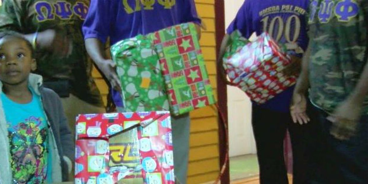 Omega Psi Phi brightens Christmas for 10 families