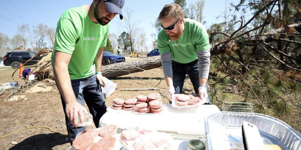 Volunteers from Publix Supermarkets serve hot meals to the Beauregard, AL community