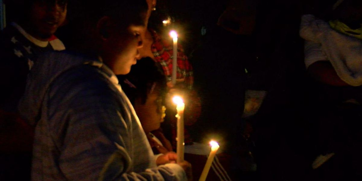 "Columbus family ""praying for justice"" at candlelight vigil for 19-year-old shot and killed"