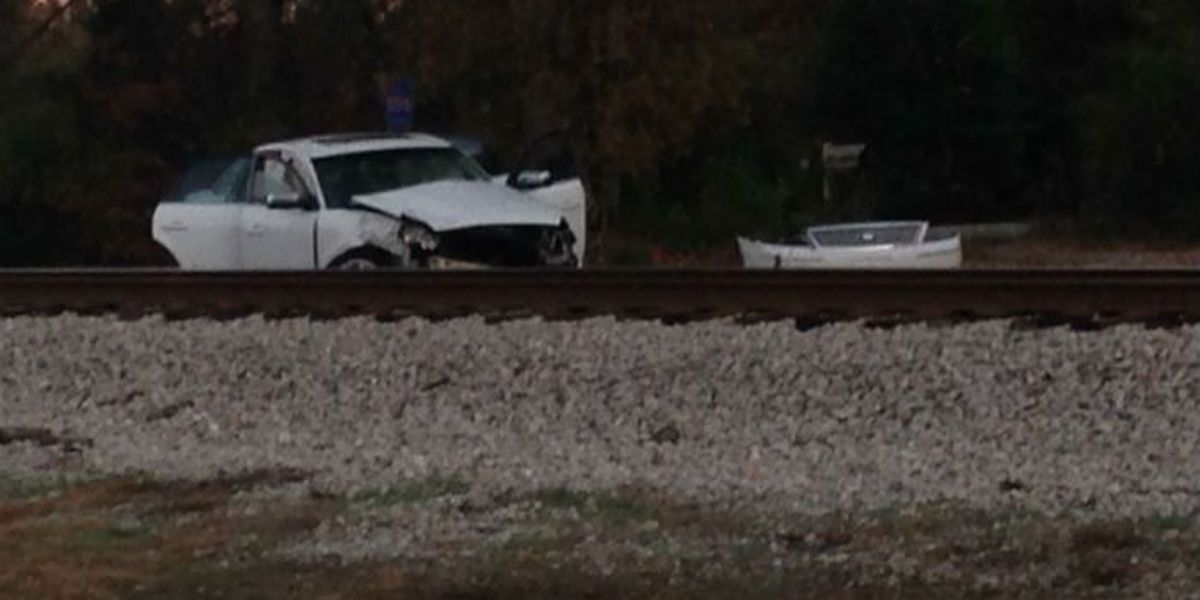 No injuries reported after car collides with train