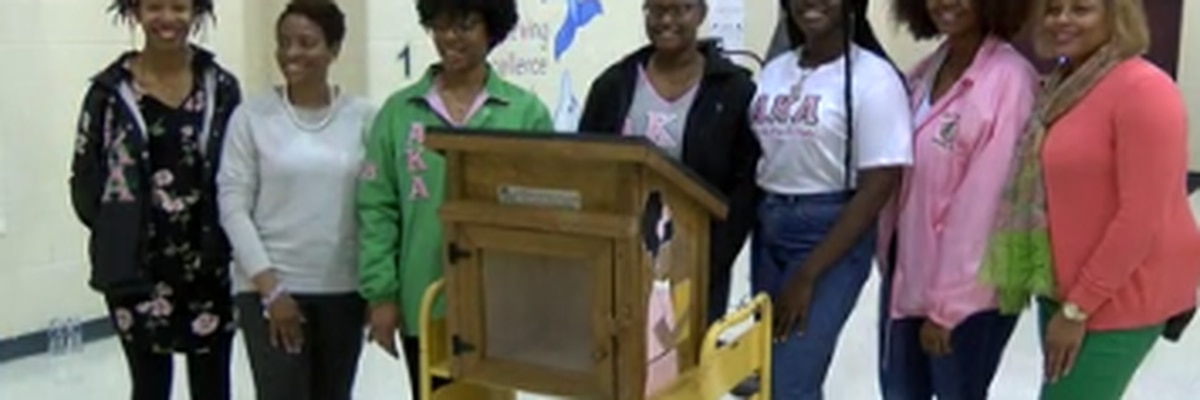 Several organizations participate in dedicating little free library to MLK Elementary School in Columbus