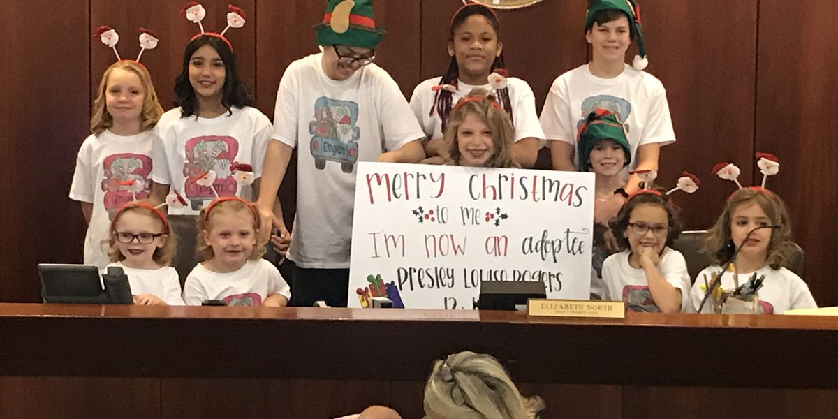 Surprise Christmas adoption brings a child to tears in Calera, Ala.
