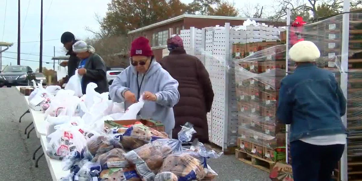 Community Warriors help neighbors in Phenix City by handing out bags of food