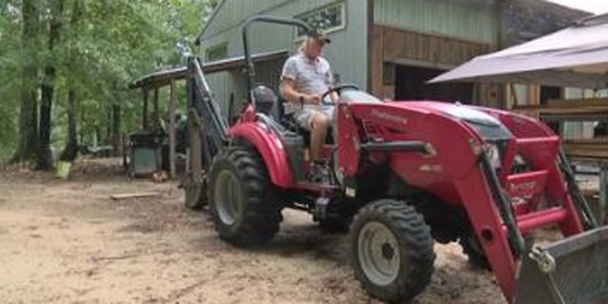 Beauregard man, with the help of his red tractor, still helping tornado survivors