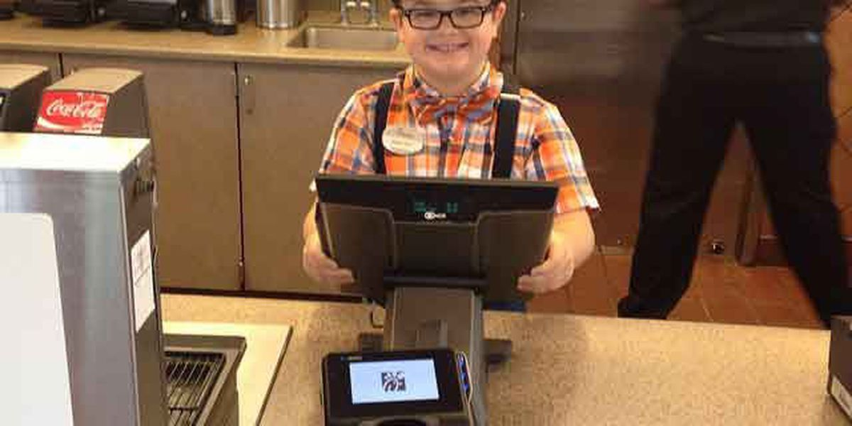 Kid follows dad's footsteps, works at Chick-fil-A for the summer