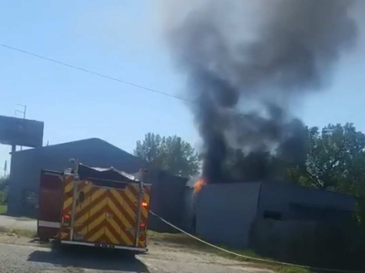 Columbus fire officials battling large fire at an old auto shop