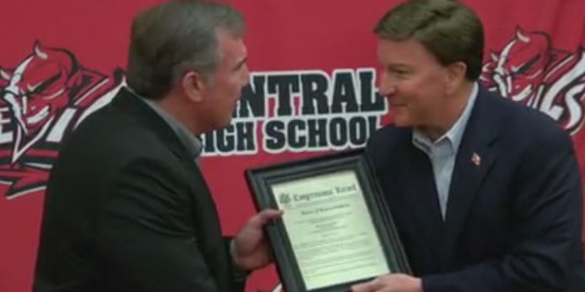 Supt. of Phenix City School given Congressional Record by Congressman Mike Rogers