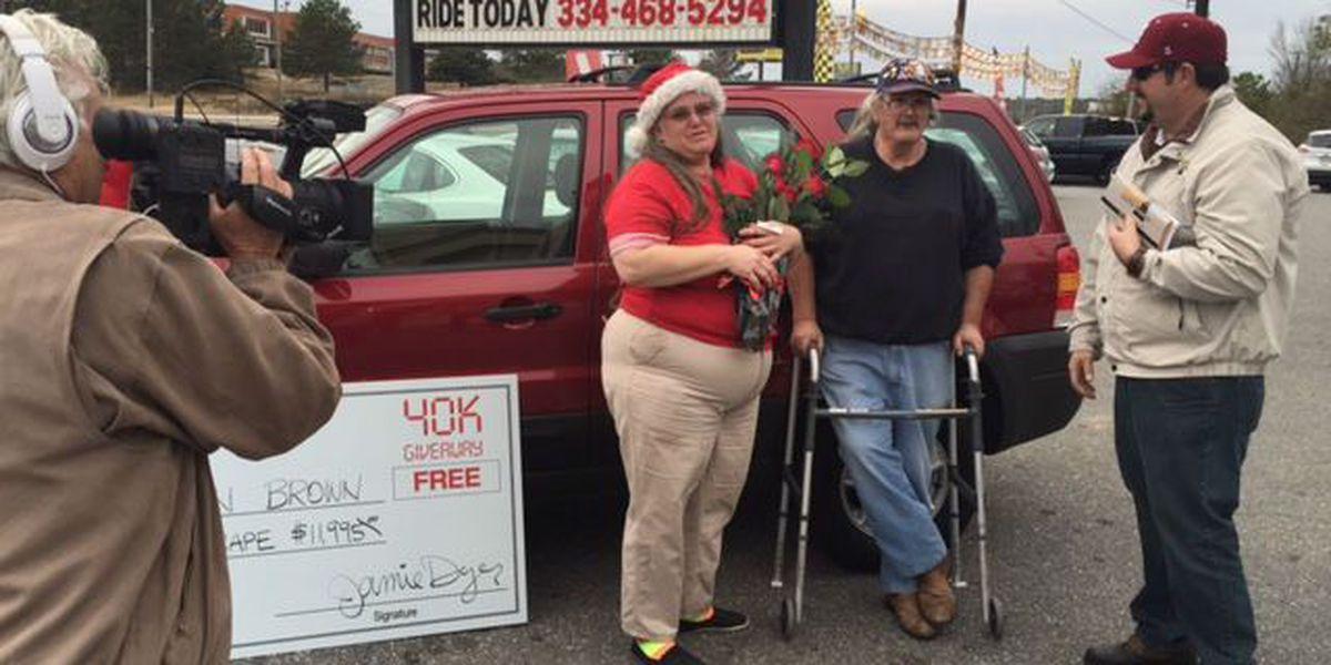 Woman wins car as 40,000th customer at Gil's Auto Sales