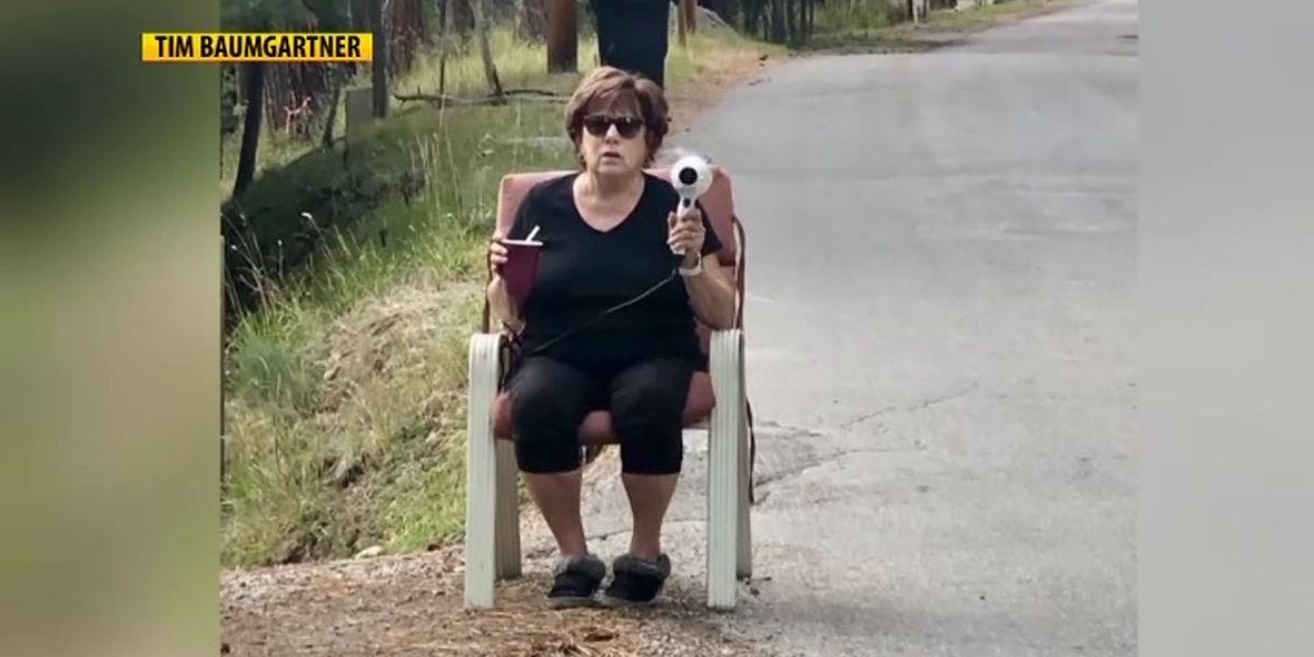 In viral photo, Montana woman uses hair dryer to stop speeders in her neighborhood