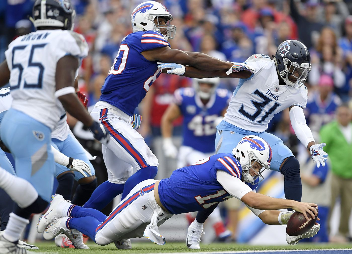 cheaper 509ba af772 Buffalo Bills quarterback Josh Allen (17) dives in for a touchdown run  against the