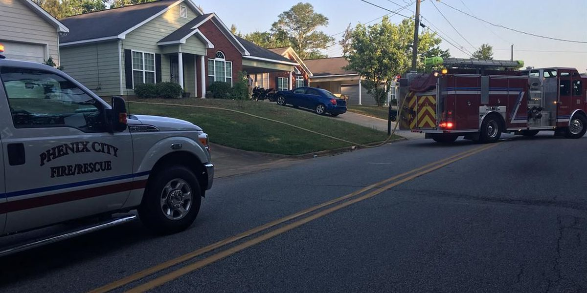 Phenix City Fire Dept. responding to contained fire near a house