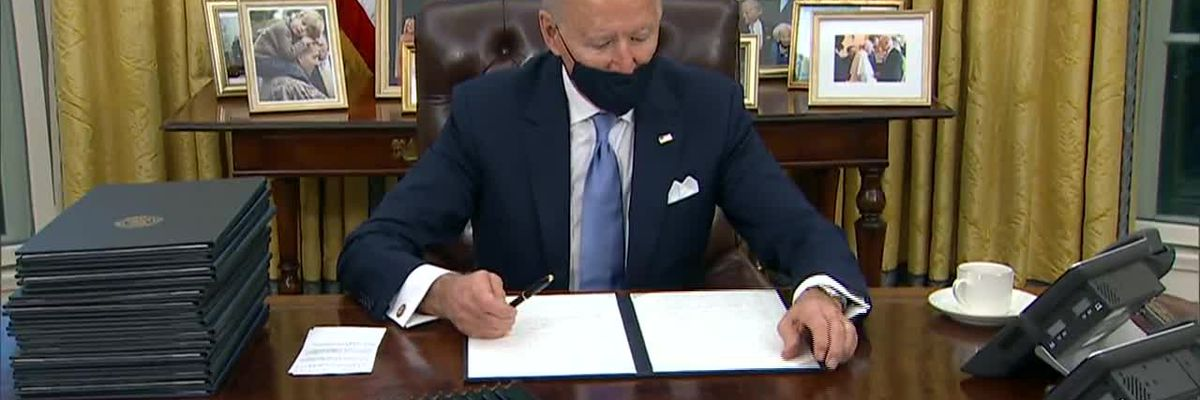Biden signs executive actions on COVID, Paris Climate Accord