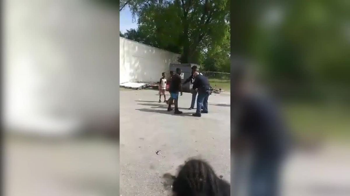 CPD officers play game of basketball with kids in the community