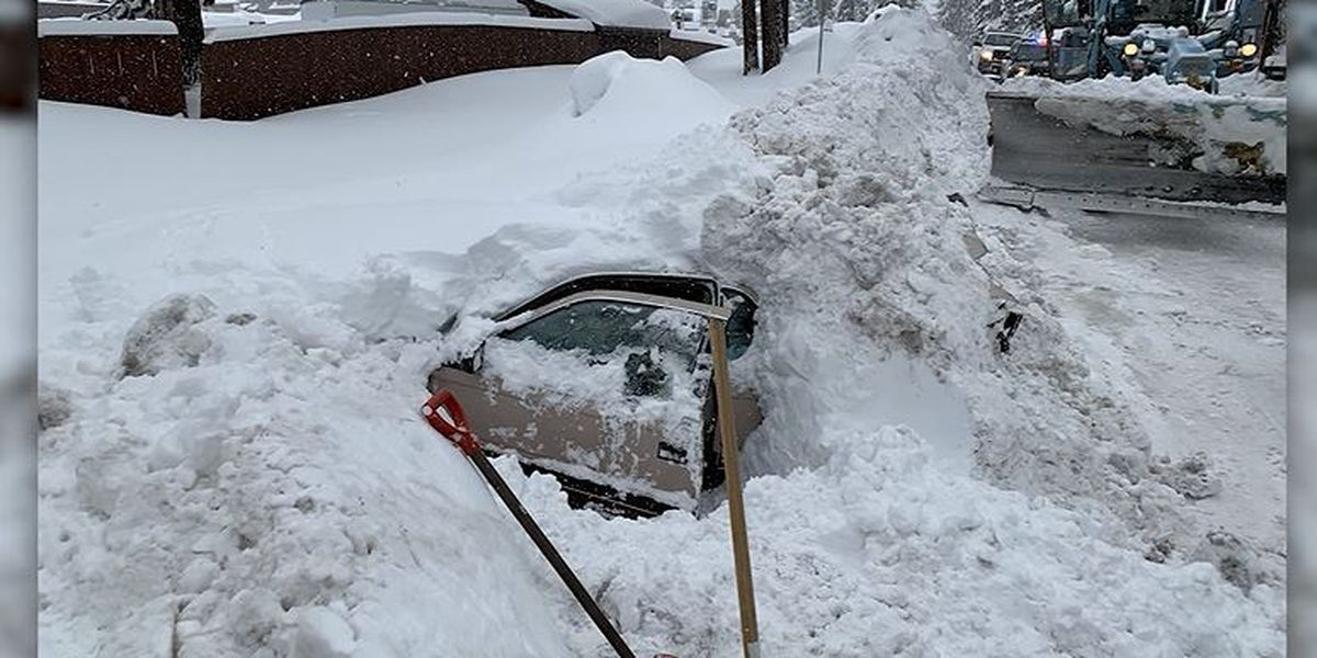 Snowplow driver finds woman trapped inside car, buried in snow