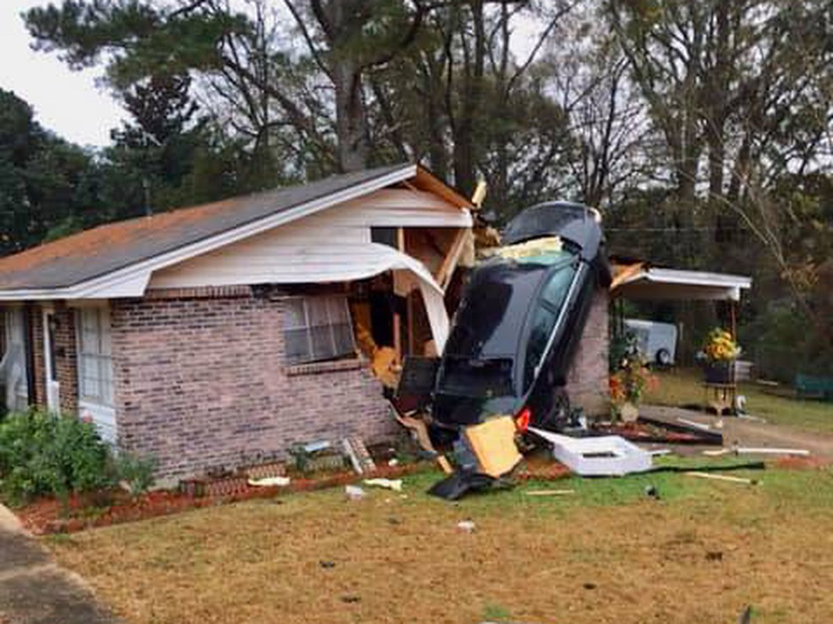 Car crashes into Montgomery home Sunday morning