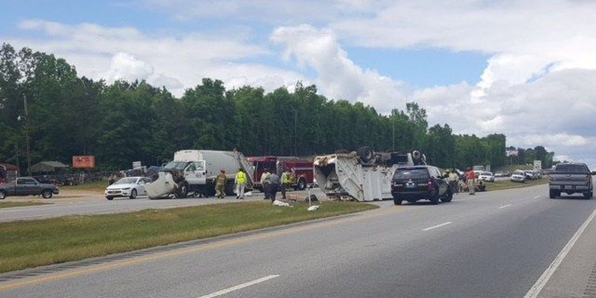 Garbage truck flips over following collision on Hwy 431 in Phenix City