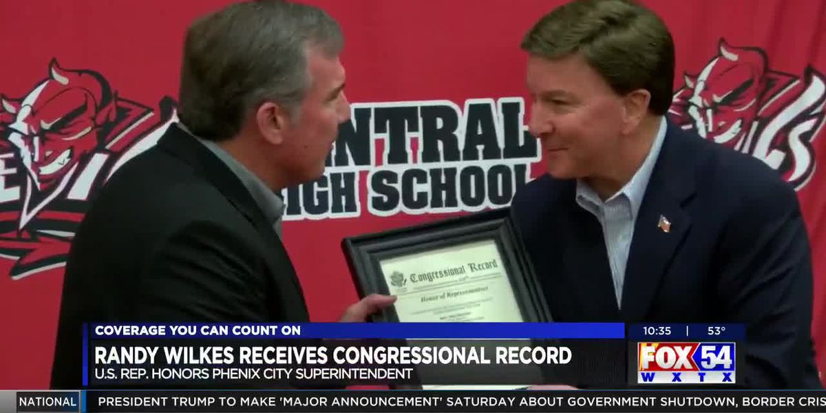 Supt. of Phenix City Schools presented with Congressional Record by Congressman Mike Rogers
