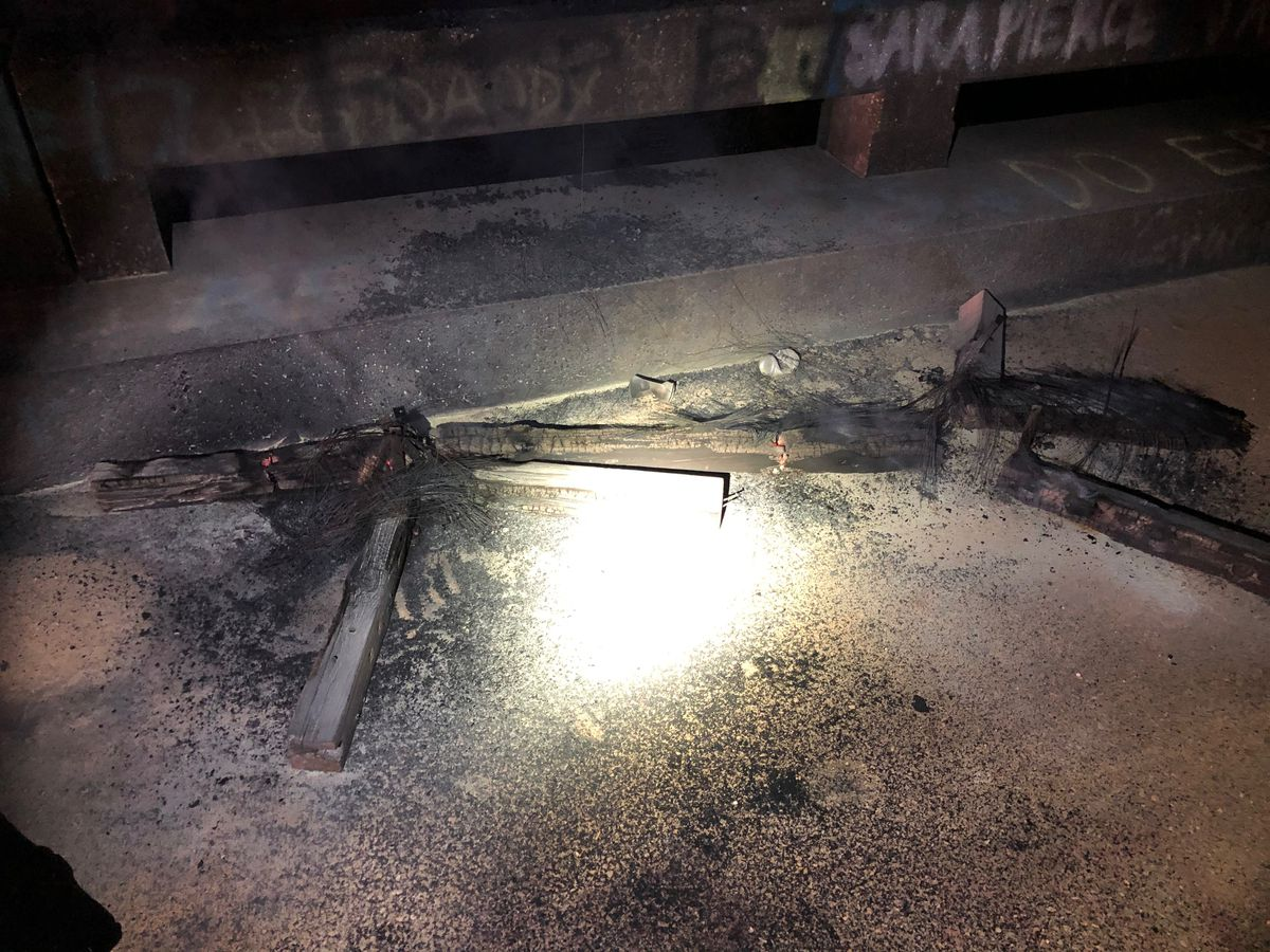 Suspects sought after burning cross left in Macon County